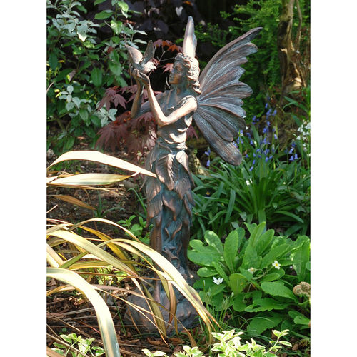 Fairy Holding a Bird Sculpture