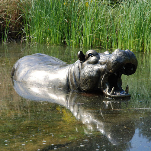 Half Hippo Lying in the Ground Sculpture