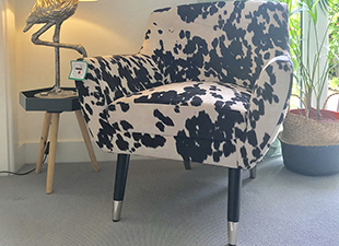 faux_black_and_white_cowhide_armchair